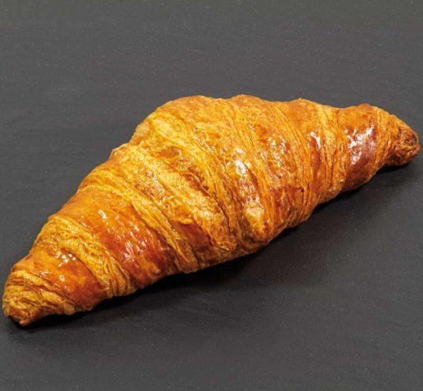 Classico croissant vuoto dritto con impasto al burro e laminato con margarina.