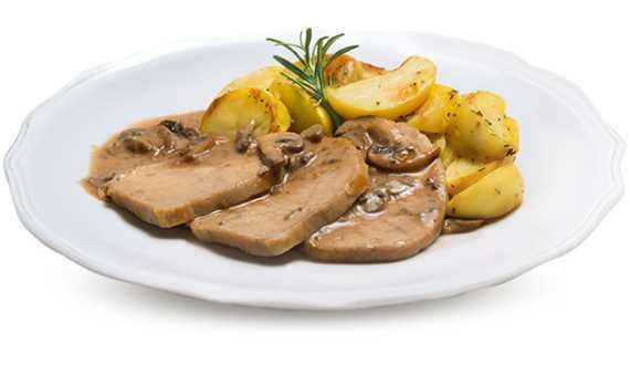 Filone di maiale con salsa ai funghi e contorno di patate.