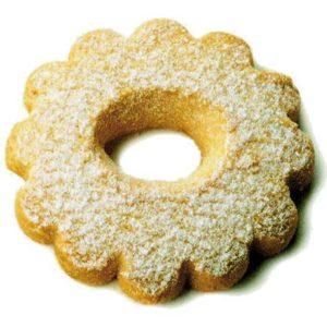 Dolce tradizionale a forma di fiore cosparso di zucchero al velo.